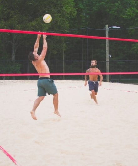 men playing beach volleyball at sportscenter