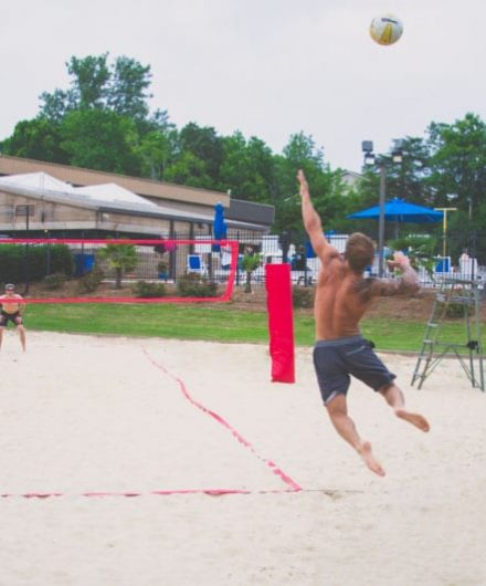 man serving during beach volleyball game