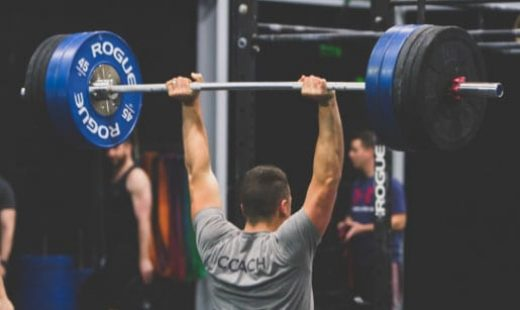 man lifting weights during crossfit training