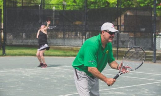 people playing tennis at fitness center