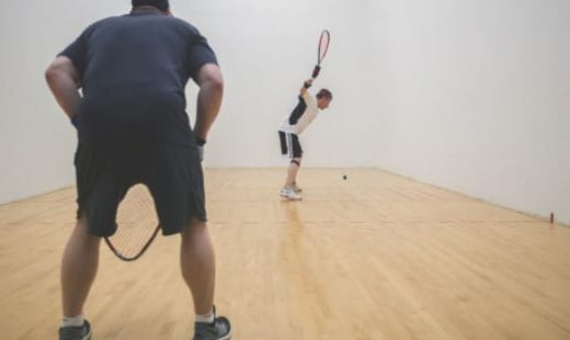 two men playing racquet ball at sportscenter