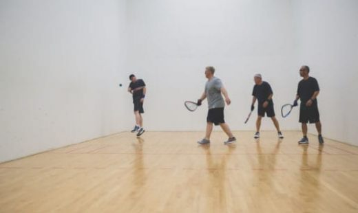men playing racquetball game