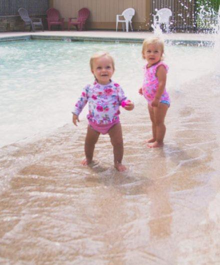 babies enjoying splash park at sportscenter