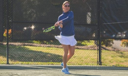 woman playing tennis at sportscenter