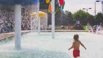 child in splah park in concord