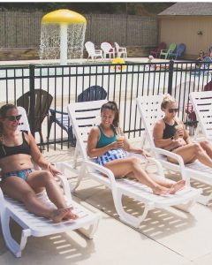 women at an outdoor pool in concord nc