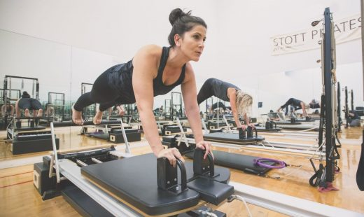 woman doing reformer pilates in best gym