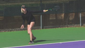 tennis player on modern tennis court in concord